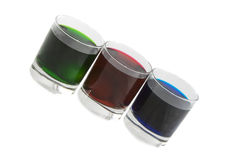 Three glasses with multi-coloured cocktails Royalty Free Stock Photos