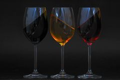 Three glasses with oblique liquid Stock Images