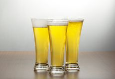 Three Glasses Of Light Beer Royalty Free Stock Photography