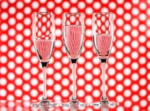 Free Three Glasses Of Water On A Red Circle Background Showing Refraction. Canvas Wall Art Royalty Free Stock Photo - 116491265