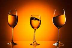 Three glasses on orange background Royalty Free Stock Photo