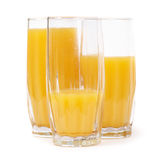 Three glasses with orange juice Stock Photos