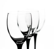 Three glasses in the outgoing term. Three glasses with black legs in the outgoing term Royalty Free Stock Photo