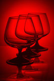 Three glasses in red light Stock Image