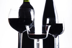 Three glasses with red wine and bottle. Of red wine royalty free stock photo