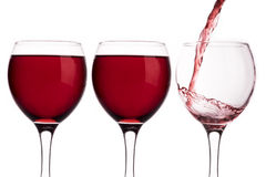 Three glasses with red wine isolated on white background Royalty Free Stock Photo