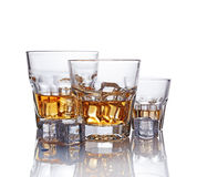 Three glasses of scotch whiskey with ice cube Royalty Free Stock Image