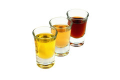 Three glasses with several liquids Stock Photography