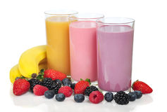 Three glasses of  smoothies. With different berries and bananas Royalty Free Stock Images