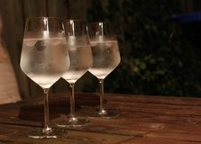 Three glasses of sparkling wine on the table. royalty free stock photos