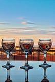 Three glasses at sunset Royalty Free Stock Image