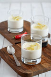 Three glasses of tasty panna cotta on the cutting boards stock images