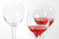 Three glasses of transparent red liquor Stock Photos