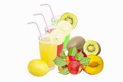 Three glasses of various juices and fruit Royalty Free Stock Image