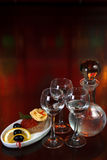 Three glasses of vodka and a bottle Royalty Free Stock Photography