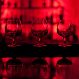 Three glasses of whiskey. On the bar Stock Photography