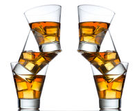 Three glasses of whiskey on the rocks isolated Stock Images