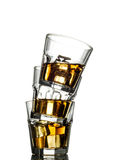 Three glasses of whiskey on the rocks Royalty Free Stock Photos