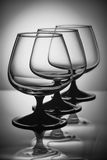 Three glasses in white light Royalty Free Stock Photo