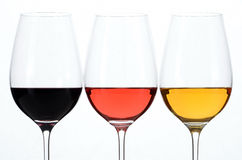 Three glasses with white, rose and red wine. Stock Photo