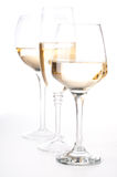 Three glasses of white wine Stock Images