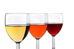 Three Glasses of Wine. Three different glasses of wine on a white background. Chardonnay, White Zinfandel, and Cabernet Sauvignon wines in three overlapping Stock Image