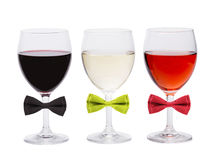 Three glasses of wine and bow tie. Stock Image