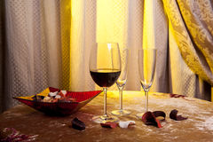 Three glasses of wine on a table in a vintage room Royalty Free Stock Images