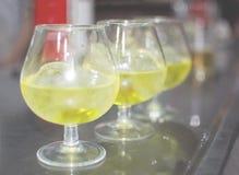 Three glasses with hierbas liquor Royalty Free Stock Photos