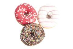 Three glazed donuts isolated on white Stock Photo