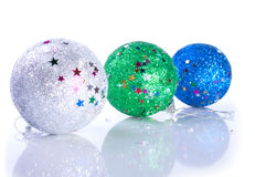 Three glistering Christams ball toys Stock Images