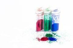Three glitter bottles stock photo