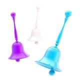 Three glossy handbells isolated. Three glossy blue, violet and white handbells isolated on white Stock Image