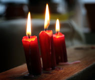 Three glowing candles Royalty Free Stock Images