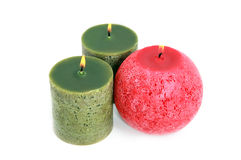 Three glowing candles on white Stock Photo