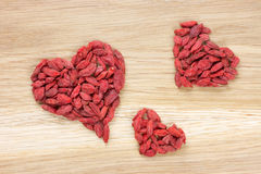 Three goji berry hearts Royalty Free Stock Images