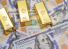 Three gold bar with new american hundred dollar bills Stock Image