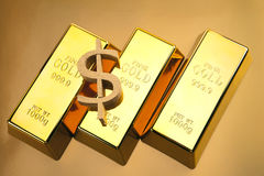 Three gold bars closeup and dollar mark Stock Photo