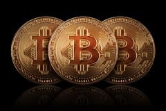 Three Gold Bitcoin on dark background. Banking business. Royalty Free Stock Photography