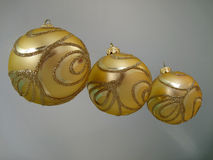 Three gold  christmas balls. On blue Stock Photos
