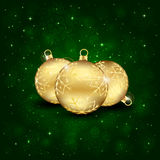 Three gold Christmas balls Stock Images