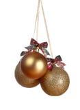 Three gold Christmas balls Stock Photos