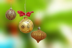 Three gold christmas baubles Royalty Free Stock Image