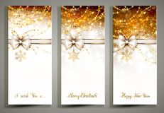 Three gold Christmas greeting cards with bow. Three gold Christmas greeting cards with decorative snowflakes and white bow Stock Photos