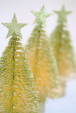 Christmas  ornaments. Three little sparkly Xmas trees against a white background Royalty Free Stock Photography