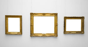 Three gold empty frame on white wall Royalty Free Stock Image