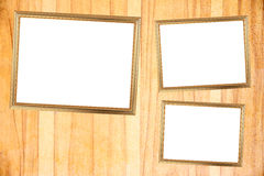 Three Gold frame on Through burnish the wood planks to polished Royalty Free Stock Images