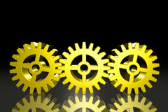 Three Gold Gears. Three (3) Gold Gears connected together on a dark background stock illustration