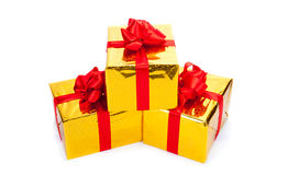 Three gold gift boxes Stock Photos