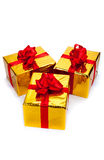 Three gold gift boxes. On white background Stock Photo